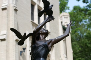 statue of lady with birds