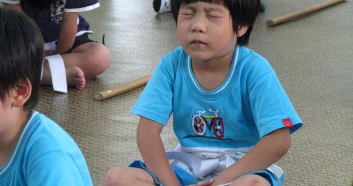 kid-meditating-really-hard